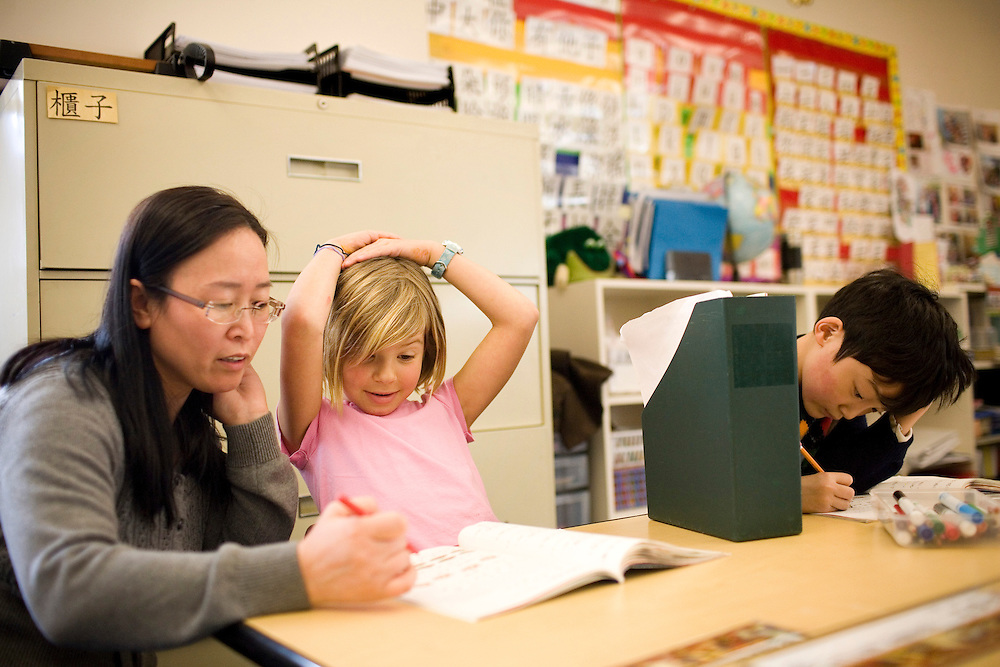 First grader Martha Chessen, 6, receives help from her instructor Xiu Geng on math in Mandarin class at the Chinese American International School, a prekindergarten through eighth grade Chinese-immersion private school, in San Francisco, Ca., on Tuesday, March 22, 2011. The school has become one of the most competitive to get into in San Francisco. Only a third of its students come from Asian families, and even many of those families do not speak Chinese. Yet parents are relying on Chinese language skills for their kids' future. Lianne Milton for The Wall Street Journal
