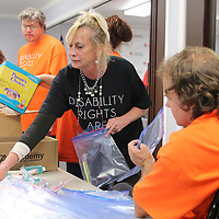 Cheryl Falzone, President of The Northeast Mississippi Chapter of Arc, helps assemble comfort kits with other Arc members at the American Red Cross office in Tupelo Friday morning. The Arc members also donated some supplies for kits that are distributed during emergencies and natural disasters. The Tupelo office of The American Red Cross have gone through aal their comfort kits with so many recent disasters.