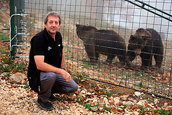 ROMANIA ZARNESTI 29OCT12 - Victor Watkins, Wildlife Advisor for the World Society for the Protection of Animals observes Eurasian brown bears at the Zarnesti Bear Sanctuary in Romania, funded by WSPA.......With over 160 acres (70 hectares) spread over a wooded hillside, it is Romania's first bear sanctuary and today houses 67 bears rescued from ramshackle zoos and cages at roadside restaurants.....jre/Photo by Jiri Rezac / WSPA....© Jiri Rezac 2012