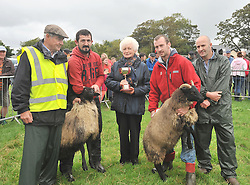 Kitty Grady presented the Austin Grady memorial cup to Peter Heraty Tiernacrogha for 1st place for Pen of two Ewes lambs at Murrisk Pattern Day, alongside are John Joe Gavin, Kevin Heraty and Joe McEvilly (Judge).<br /> Pic Conor McKeown