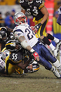 PITTSBURGH - JANUARY 23:  Running back Corey Dillon #28 of the New England Patriots cuts hard to avoid a tackle by linebacker Joey Porter #55 of the Pittsburgh Steelers during the AFC Championship game at Heinz Field on January 23, 2005 in Pittsburgh, Pennsylvania. The Pats defeated the Steelers 41-27. ©Paul Anthony Spinelli  *** Local Caption *** Corey Dillon; Joey Porter