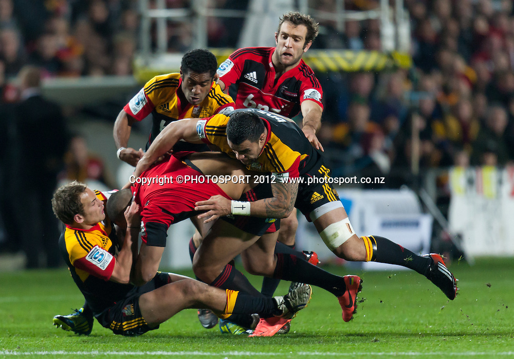 Crusaders' Robbie Fruean is tackled to the ground by Andreww Horrell, Liam Messam and Asaeli Tikoirotumaduring the Super Rugby Semi Final won by the Chiefs (20-17) against the Crusaders at Waikato Stadium, Hamilton, New Zealand, Friday 27 July 2012. Photo: Stephen Barker/Photosport.co.nz