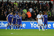 a dejected Swansea city capt Ashley Williams looks on as Chelsea players celebrate their 5th goal scored by Andre Schurrle.  Barclays Premier League match, Swansea city v Chelsea at the Liberty Stadium in Swansea, South Wales on Saturday 17th Jan 2015.<br /> pic by Andrew Orchard, Andrew Orchard sports photography.