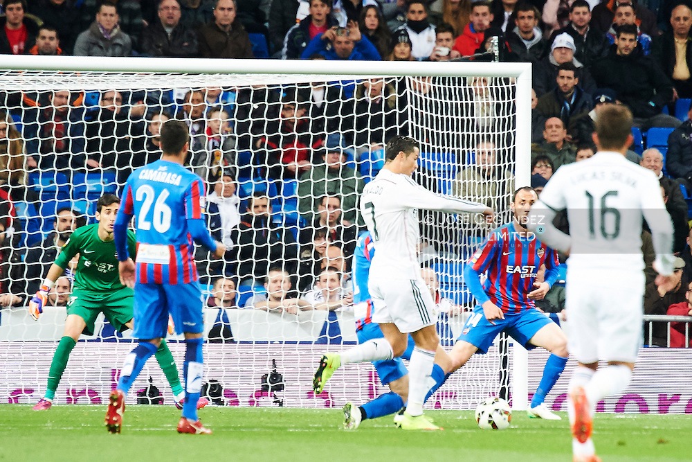 Cristiano Ronaldo (Real Madrid F.C.) and Camarasa (Levante) action during Real Madrid v Levante CF, La Liga football match at Santiago Bernabeu on March 15, 2015 in Madrid