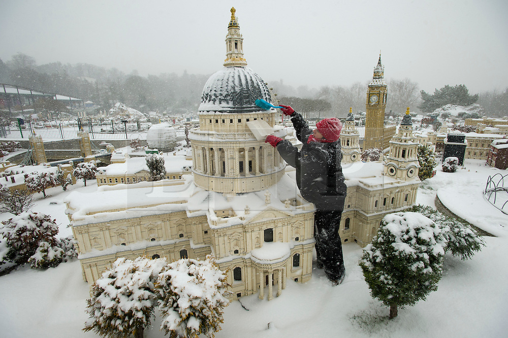 ©  London News Pictures. 18/01/2013. Windsor, UK. Model maker Paula Laughton brushing snow from a model  of St Paul's Cathedral in London Mininland at LEGOLAND Windsor resort in Windsor, Berkshire.  Photo credit : Ben Cawthra/LNP