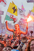 Pilton, Somerset, UK. 29th June 2019. Fans let off flares as Liam Gallagher plays the Pyramid Stage - The 2019 Glastonbury Festival, Worthy Farm, Glastonbury.