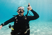 Buoyancy compensator Inflator tube. Underwater Hand signs scuba diver demonstrates the sign language for divers.