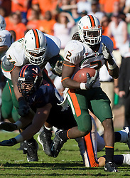 Miami (FL) running back Graig Cooper (2) rushes against UVA.  The Miami Hurricanes defeated the Virginia Cavaliers 24-17 in overtime in a NCAA Division 1 Football game at Scott Stadium on the Grounds of the University of Virginia in Charlottesville, VA on November 1, 2008.