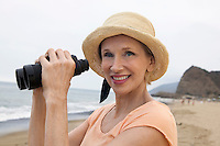 Woman at Beach Using Binoculars