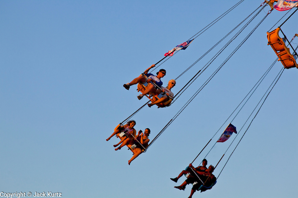 "01 SEPTEMBER 2011 - ST. PAUL, MN:  People on the Sky Flyer on the midway at the Minnesota State Fair. The Minnesota State Fair is one of the largest state fairs in the United States. It's called ""the Great Minnesota Get Together"" and includes numerous agricultural exhibits, a vast midway with rides and games, horse shows and rodeos. Nearly two million people a year visit the fair, which is located in St. Paul.   PHOTO BY JACK KURTZ"