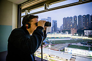 Edward Sadler calls the Barrier Trails at Happy Valley Racecourse on January 20, 2018 in Happy Valley Hong Kong. (Photo: Alex Evers)