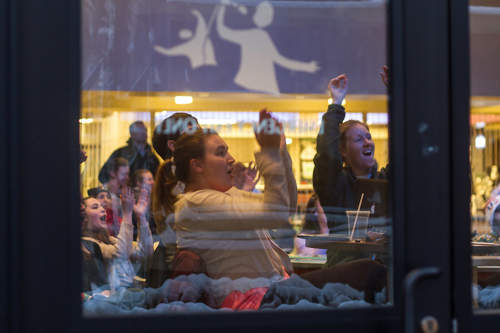 Students in Hotung Cafe watch a live-stream of the NCAA Division III Women's Basketball Championship game, which Tufts lost 51-63 to Thomas More, on April 4 2016. (Max Lalanne / The Tufts Daily)