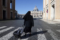 March 18,  2020, Rome, Italy: St. Peter's Square and the streets of Rome, deserted, with only a few people with masks against the coronavirus pandemic. Only police and military. Pope Francis makes his Wednesday general audience via tv streaming. (Credit Image: © Evandro Inetti/ZUMA Wire)