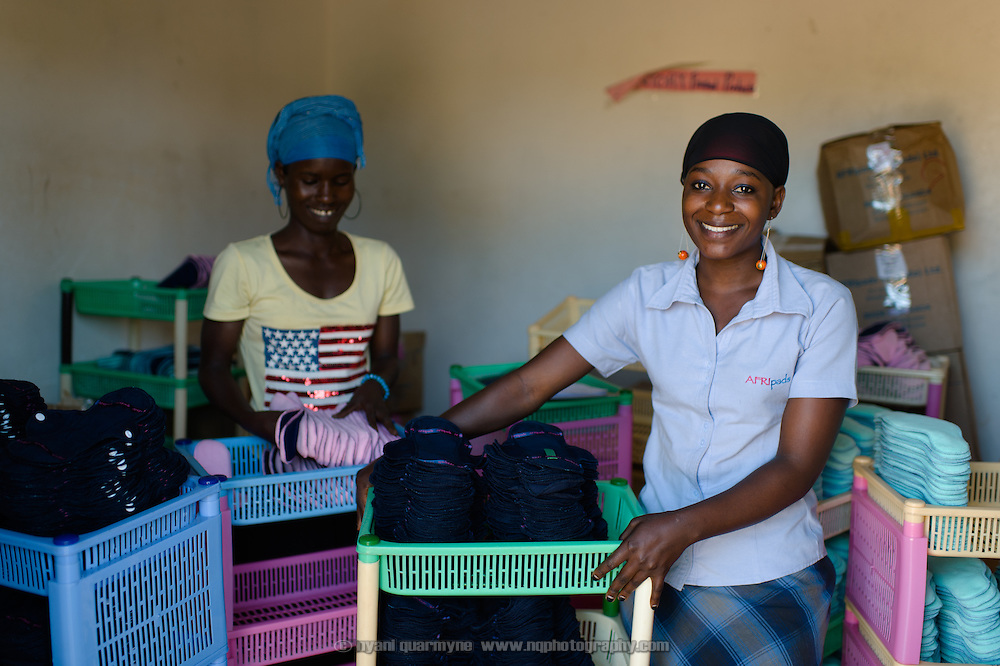 Makula Hajarah (right), Quality Control Supervisor, at the Afripads factory in the village of Kitengeesa in the Central Region of Uganda on 30 July 2014. With her is Rose Nalule.