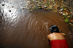 April 26, 2017 - Kathmandu, Nepal - A Nepalese devotee takes a holy bath in memory of her departed mother on Mothers Day in Kathmandu, Nepal. (Credit Image: © Skanda Gautam via ZUMA Wire)