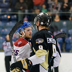 KINGSTON, - Apr 6, 2016 -  Ontario Junior Hockey League game action between Trenton Golden Hawks and Kingston Voyageurs. Game 4 of the North East Championship series.  at the Invista Centre, ON. Colin Tonge #15 of the Kingston Voyageurs and Mitch Emerson #9 of the Trenton Golden Hawks shake hands. (Photo by Ian Dixon / OJHL Images)