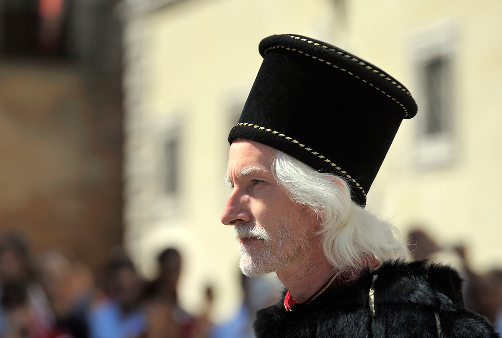 Montepulciano, Tuscany, Italy. Man dressed in Renaissance costume during annual wine festival known as the Bravio delle Botti