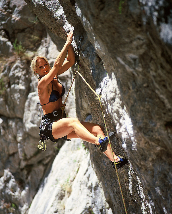 San Diego Fitness Photographer: Young woman rock climbing at Big Bear, CA.