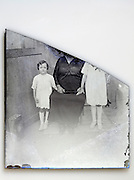 broken glass plate with portrait of mother with children