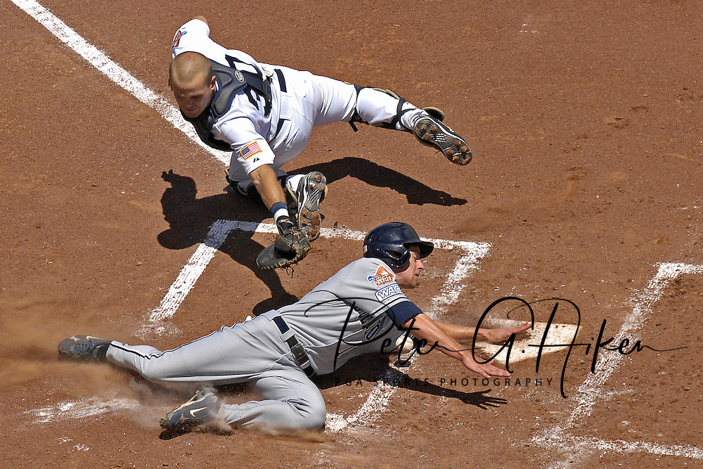 Fresno State Bulldogs shortstop Danny Muno (16) slides and scores around the attempted tag at home plate by Rice Owls catcher Adam Zornes (30) during the College World Series at Rosenblatt Stadium in Omaha, Nebraska on June 15, 2008.