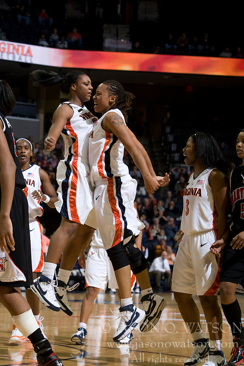 Virginia guard Monica Wright (22) and Virginia forward Lyndra Littles (1) celebrate during the Maryland game.  The Virginia Cavaliers women's basketball team faced the #4 ranked Maryland Terrapins at the John Paul Jones Arena in Charlottesville, VA on January 18, 2008.