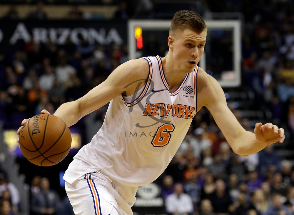 New York Knicks forward Kristaps Porzingis (6) in the first half during an NBA basketball game against the Phoenix Suns, Friday, Jan. 26, 2018, in Phoenix. (AP Photo/Rick Scuteri)