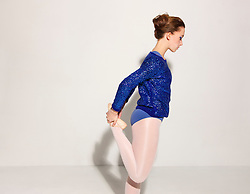 Side View of Ballet Dancer Stretching Leg