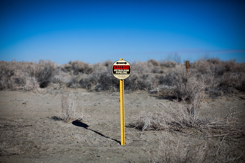 Warning signs for the jet fuel pipeline that runs through Fallon, Nevada are scattered through April Brune's former neighborhood.