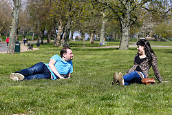 © Licensed to London News Pictures. 04/04/2020. London, UK. Members of the public enjoy the sunshine in Finsbury Park, north London and keeping 2 meters apart during coronavirus lockdown. According to the Met Office, temperature in London is likely to reach 20 degrees this weekend. The Government has ordered that people go out only for food and health reasons or for work, and keep 2 meters away from other people at all times to slow the spread of the virus and reduce pressure on the NHS. <br /> <br /> ***Permission Granted***<br /> <br /> Photo credit: Dinendra Haria/LNP