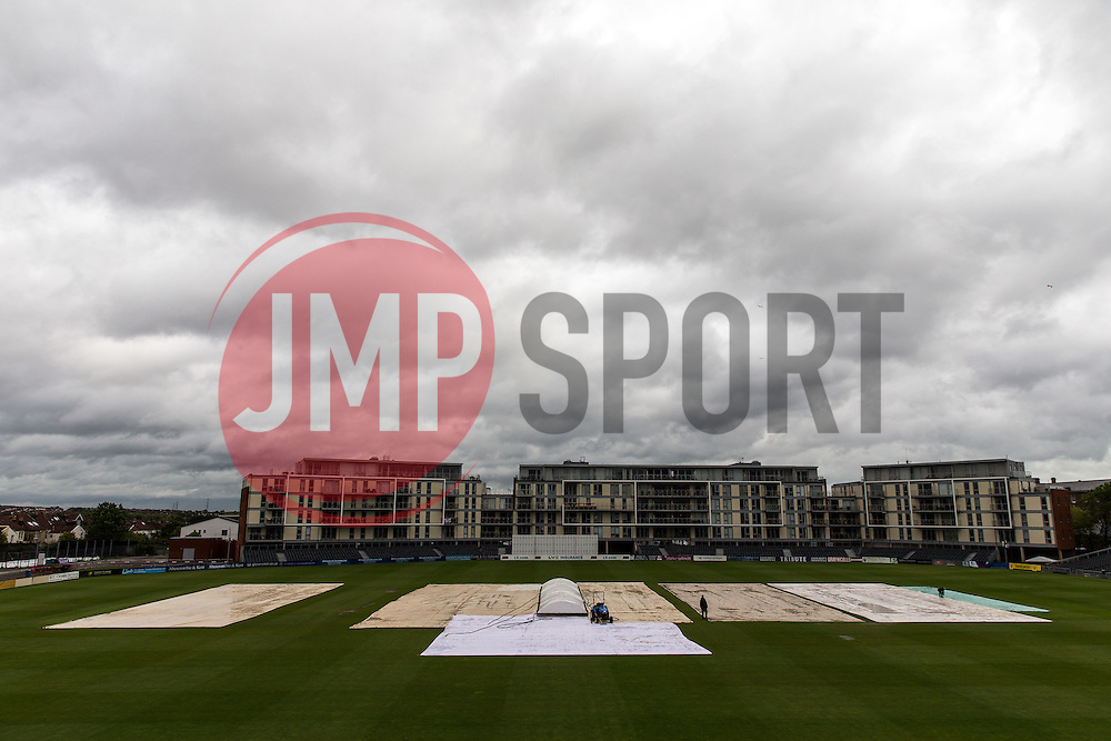 The groundsmen work on a covered wicket as play is delayed on the first morning due to rain - Photo mandatory by-line: Rogan Thomson/JMP - 07966 386802 - 18/05/2015 - SPORT - CRICKET - Bristol, England - Bristol County Ground - Gloucestershire v Kent - Day 1 - LV= County Championship Division Two.