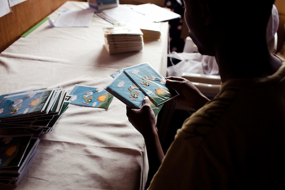 Quality control before the cards get distributed worldwide. Cards from Africa, Kigali, Rwanda. 8th April 2011