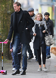 Abbey Clancy and footballer husband Peter Crouch out and about in London. The pregnant model looked happy and glowing wearing a black coat, grey top, scarf, black leggings and trainers... UK. 11/03/2015<br /> BYLINE MUST READ : JAMESY/GOTCHA IMAGES<br /> <br /> Copyright by © Gotcha Images Ltd. All rights reserved.<br /> Usage of this image is conditional upon the acceptance <br /> of Gotcha Images Ltd, terms and conditions available at<br /> www.gotchaimages.com