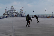 Boy practicing dance moves, Eastbourne, Pier. 16 March 2016