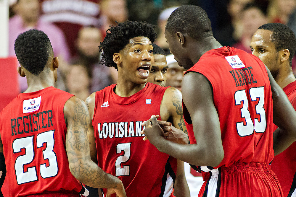 FAYETTEVILLE, AR - NOVEMBER 15:  Elfrid Payton #2 of the Louisiana Ragin' Cajuns talks with teammates during a  game against the Arkansas Razorbacks at Bud Walton Arena on November 15, 2013 in Fayetteville, Arkansas.  The Razorbacks defeated the Ragin' Cajuns 76-63.  (Photo by Wesley Hitt/Getty Images) *** Local Caption *** Elfrid Payton