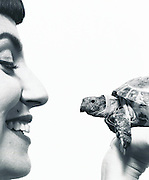 A woman with her pet turtle. (photo: Ann Summa)