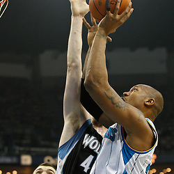 February 7, 2011; New Orleans, LA, USA; New Orleans Hornets power forward David West (30) shoots over Minnesota Timberwolves power forward Kevin Love (42) during the first quarter at the New Orleans Arena.   Mandatory Credit: Derick E. Hingle