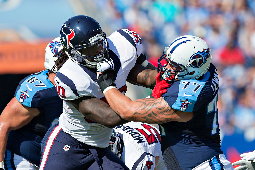 NASHVILLE, TN - OCTOBER 26:  Jadeveon Clowney #90 of the Houston Texans is blocked by Taylor Lewan #77 of the Tennessee Titans at LP Field on October 26, 2014 in Nashville, Tennessee.  The Texans defeated the Titans 30-16.  (Photo by Wesley Hitt/Getty Images) *** Local Caption ***  Jadeveon Clowney; Taylor Lewan