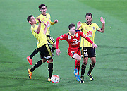 Adelaide United's Craig Goodwin breaks through 3 Phoenix defenders during the Round 22 A-League football match - Wellington Phoenix V Adelaide United at Westpac Stadium, Wellington. Saturday 5th March 2016. Copyright Photo.: Grant Down / www.photosport.nz