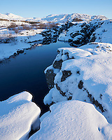 Flosagjá water filled rift in winter. Þingvellir National Park, South Iceland.
