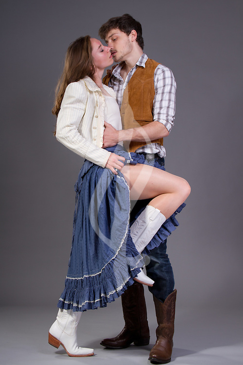 Couple posing in modern western outfits. Western/Cowboy Couple