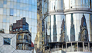 Reflections of the buildings in Stephansdom, Vienna, Austria