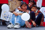 "jku032303057 - 31 JULY 2002 - MEXICO CITY, DF, MEXICO: A family on the Zocalo in the historic center of Mexico City watches a Papal mass televised to the Zocalo on large screen ""jumbotron"" televisions. The mass, led by Pope John Paul II, was at the Basilica of Guadalupe in Mexico City, July 31, 2002. The Pontiff, making his fifth trip to Mexico, canonized Juan Diego, the Mexican Indian who first saw the image of the Virgin of Guadalupe in 1531. Juan Diego is now known at Saint Juan Diego. PHOTO © JACK KURTZ  RELIGION  INDIGENOUS  CULTURE  PATRIOTISM"