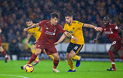 WOLVERHAMPTON, ENGLAND - Friday, December 21, 2018: Liverpool's Roberto Firmino and Wolverhampton Wanderers' Rúben Neves during the FA Premier League match between Wolverhampton Wanderers FC and Liverpool FC at Molineux Stadium. (Pic by David Rawcliffe/Propaganda)