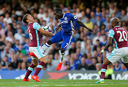 N'Golo Kante of Chelsea is challenged by Mark Noble of West Ham United - Rogan Thomson/JMP - 15/08/2016 - FOOTBALL - Stamford Bridge Stadium - London, England - Chelsea v West Ham United - Premier League Opening Weekend.