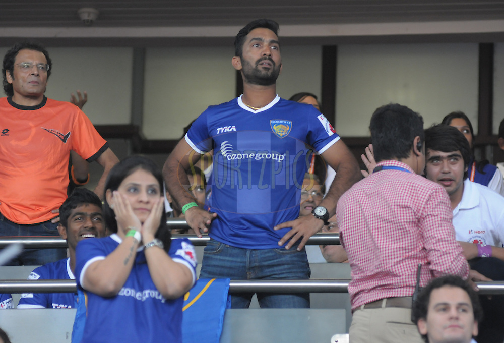 Cricketer Dinesh Karthikduring match 12 of the Hero Indian Super League between The Delhi Dynamos FC and Chennaiyin FCheld at the Jawaharlal Nehru Stadium, Delhi, India on the 25th October 2014.<br /> <br /> Photo by:  Arjun Panwar/ ISL/ SPORTZPICS