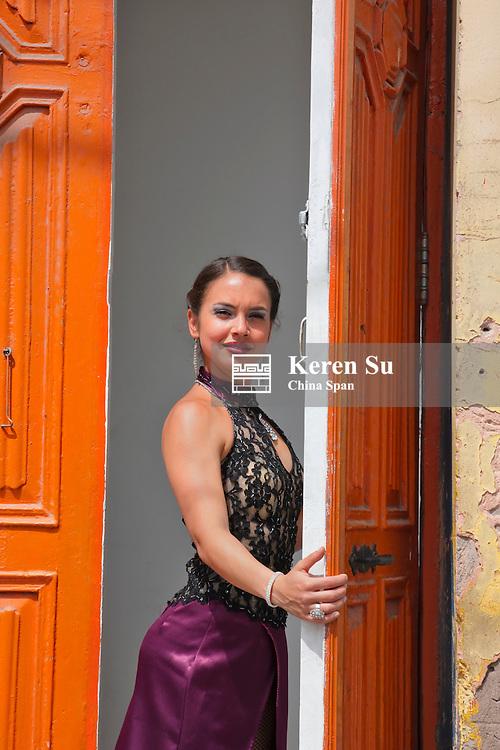 Woman by the door,  La Boca, Buenos Aires, Argentina