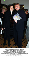 MARTIN CLUNES and his wife at a party in London on 8th January 2004.PPS 257