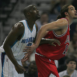 Jan 29, 2010; New Orleans, LA, USA; New Orleans Hornets center Emeka Okafor (50) and Chicago Bulls center Joakim Noah (13) fight for position under the basket during the first half at the New Orleans Arena. Mandatory Credit: Derick E. Hingle-US PRESSWIRE