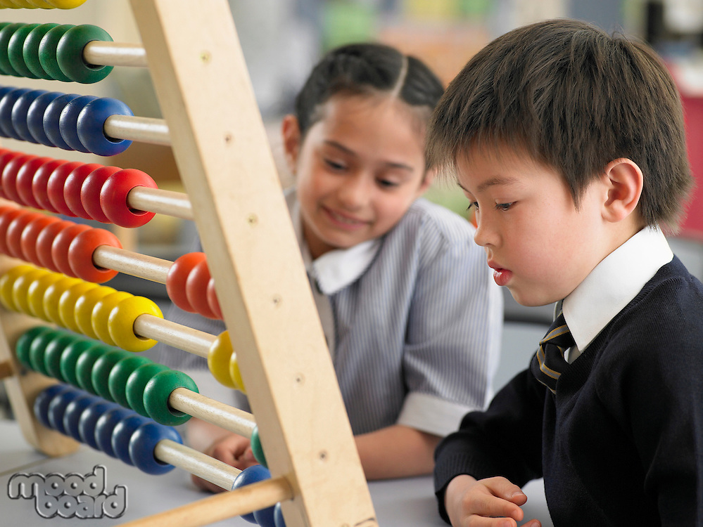 Schoolkids Using an Abacus