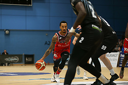 Gentry Thomas of Bristol Flyers drives at the defence - Photo mandatory by-line: Arron Gent/JMP - 07/12/2019 - BASKETBALL - Surrey Sports Park - Guildford, England - Surrey Scorchers v Bristol Flyers - British Basketball League Championship